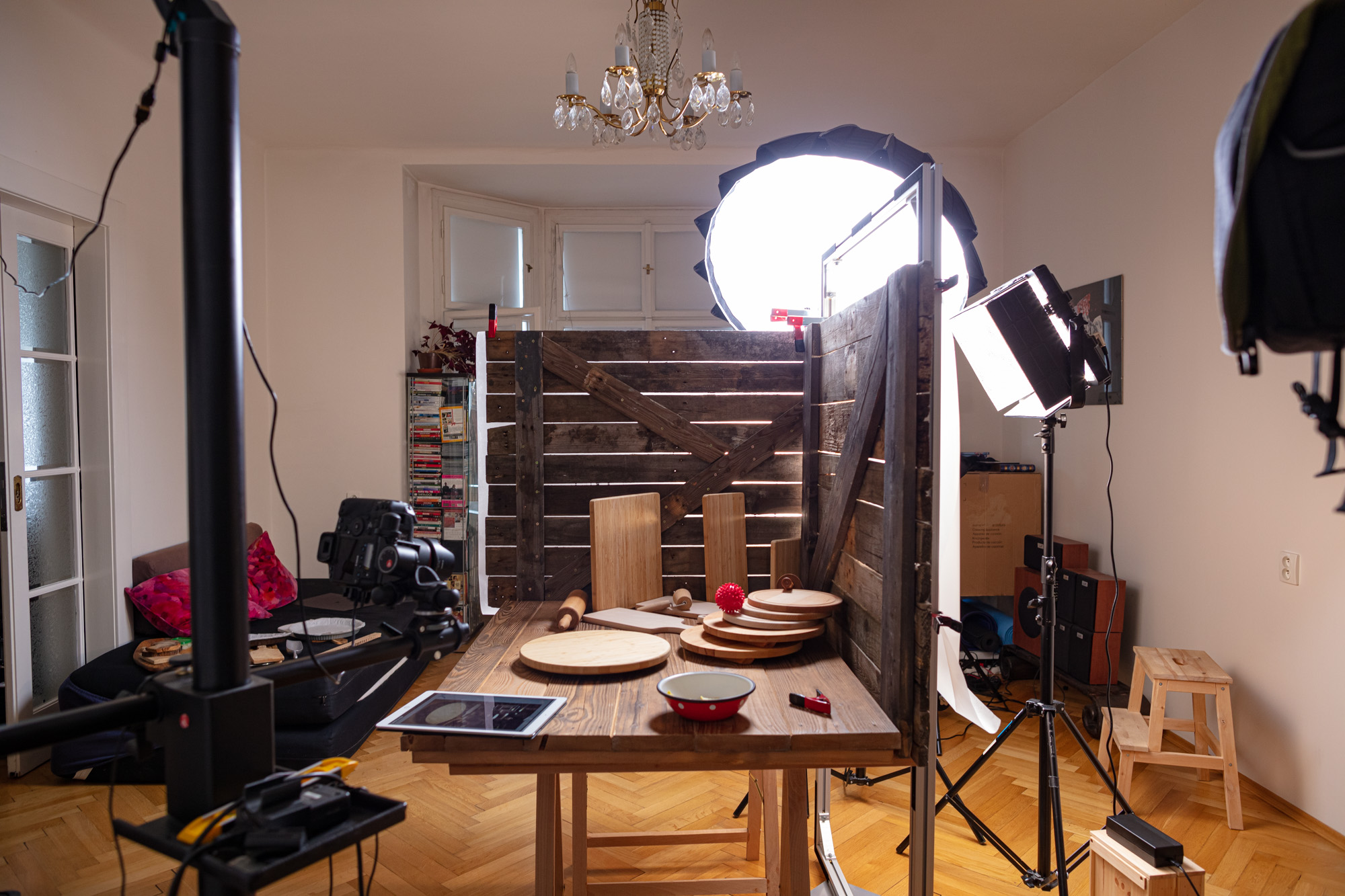 """Behind the scenes at the video production of """"Vegan Cherry Crumble Pie Recipe"""". A big table set up resembling a """"barn"""". In a studio with various lamps and cameras."""