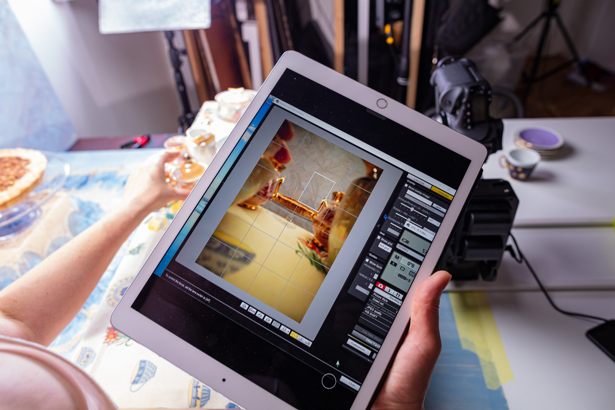 """Behind the scenes at the video production of """"Vegan Cherry Crumble Pie Recipe"""". The stylist/art director is checking the angle and camera movement on a monitor/Ipad."""