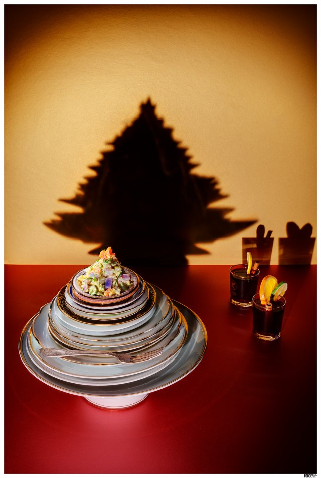 vegan potato salad on plates, all in the shape of a christmas tree