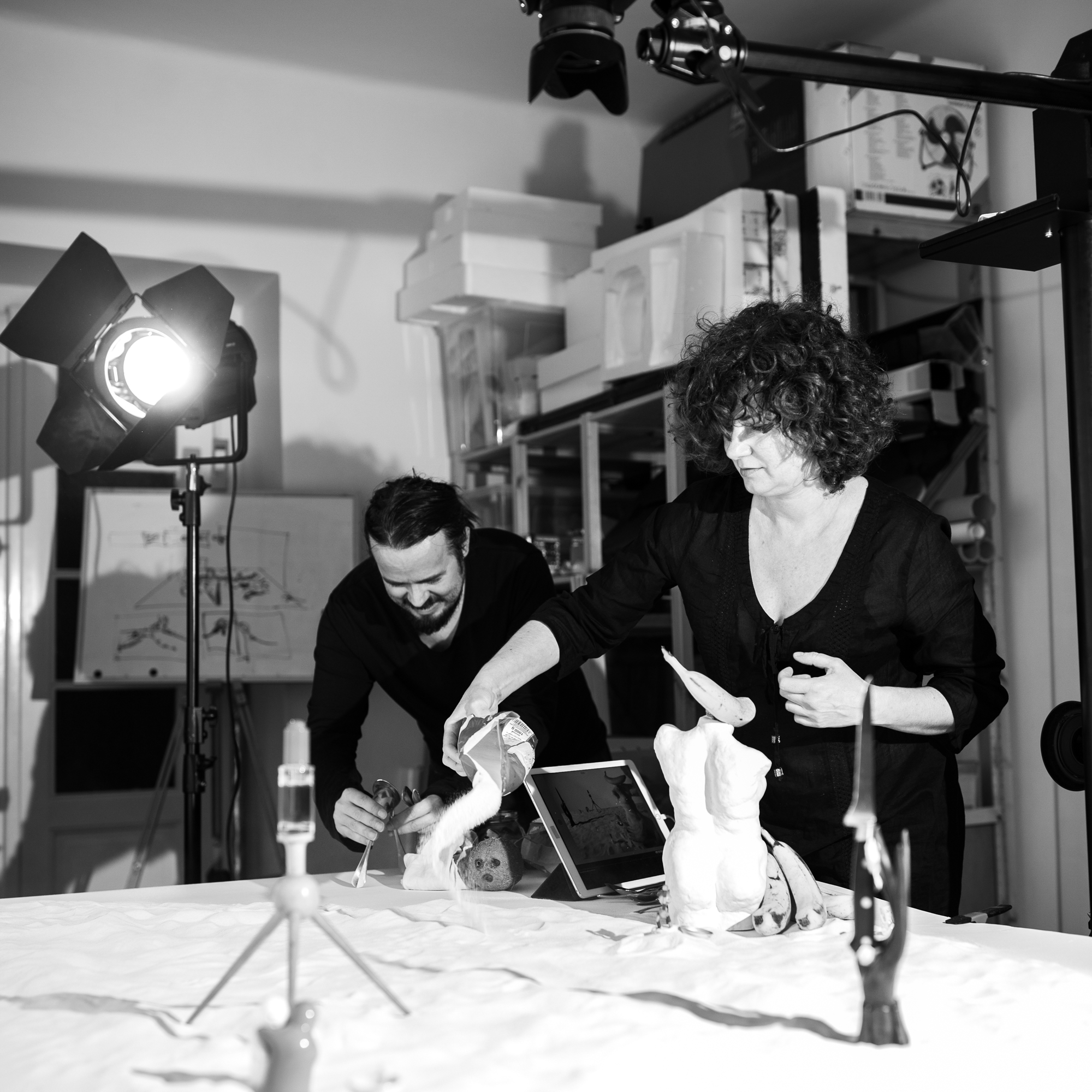 Behind the scenes of foodlydoodlydoo's vegan banana bread recipe. The photo shows photographer and stylist preparing the scene.