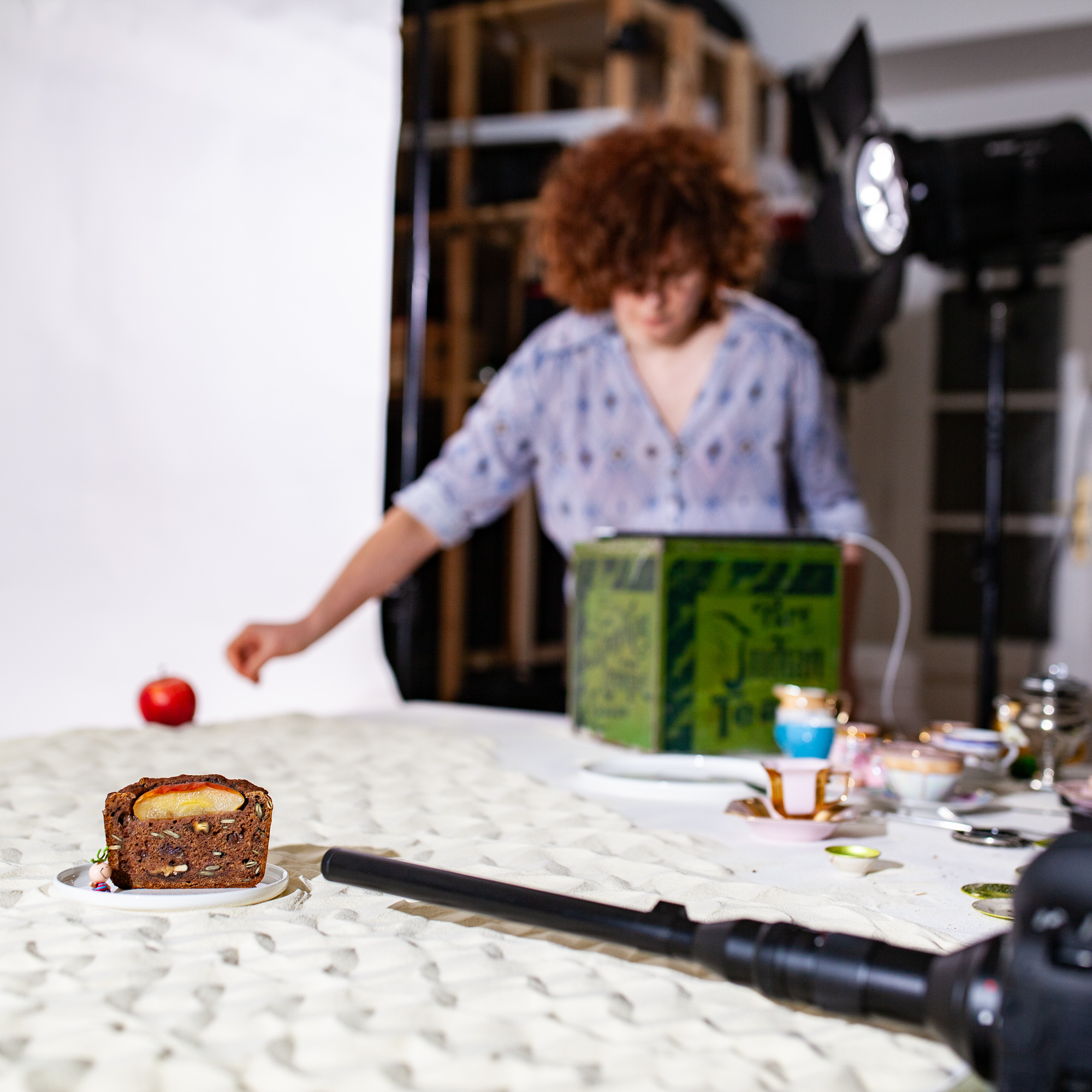 Behind the scenes of foodlydoodlydoo's vegan banana bread recipe. The photo shows the food stylist preparing the scene