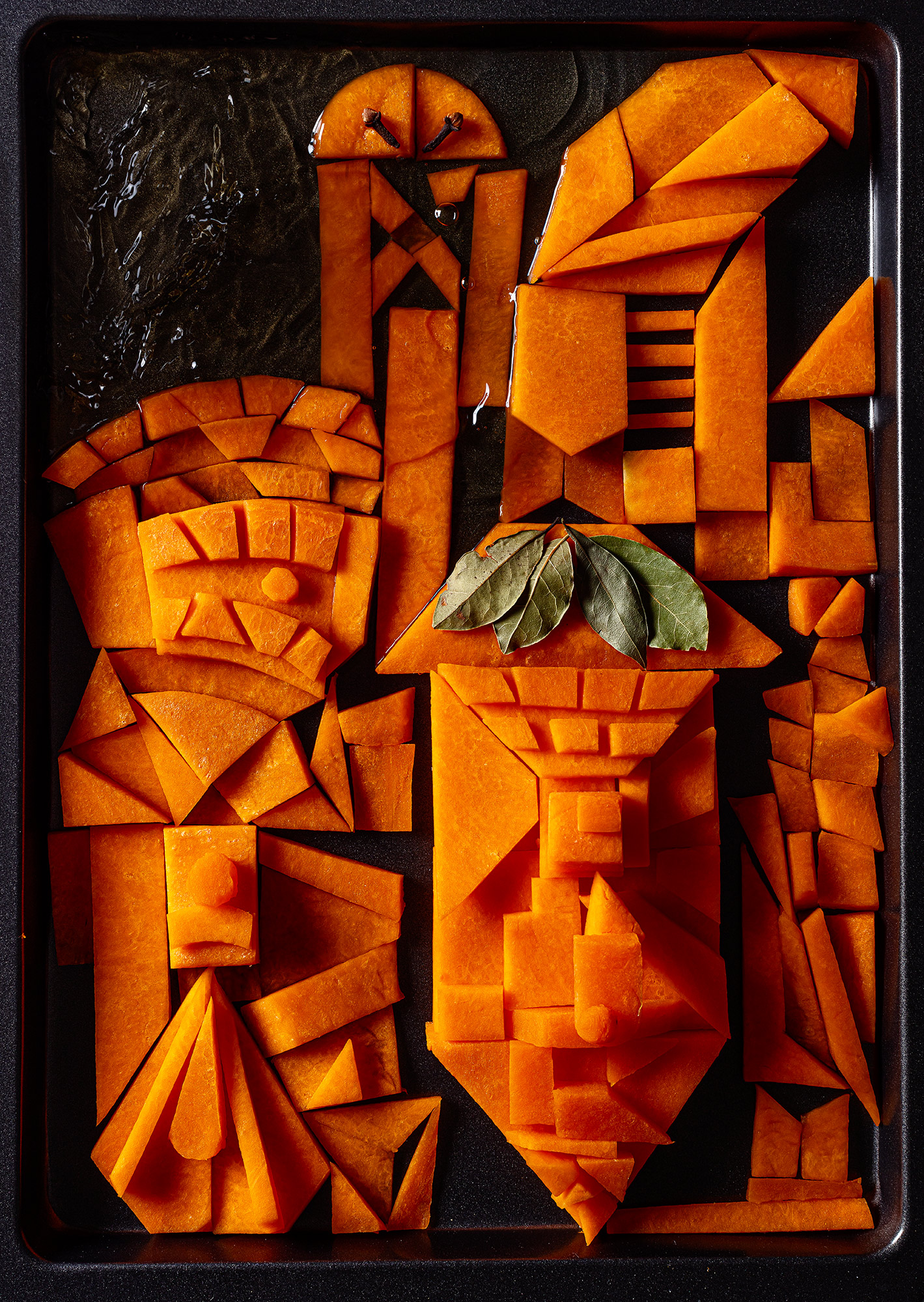 """Second step for making pumpkin ketchup. Pumpkin together with apple juice and bay leaves and cloves. The photo is inspired by an image from Paul Klee - """"Castle Garden""""."""