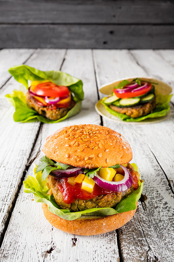 Finished vegan burgers made out of bean patties in three variations